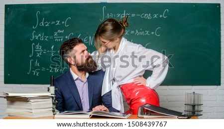 Distracting him from work. Private lesson. Check knowledge. Teacher and student in classroom chalkboard background. Sexy seduction. Desire for knowledge. Sex knowledge. Need for real experience. #1508439767