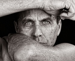 Distressed Man Framing His Face with His Arms