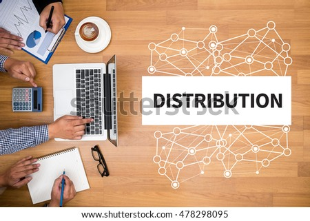 DISTRIBUTION  Business team hands at work with financial reports and a laptop #478298095