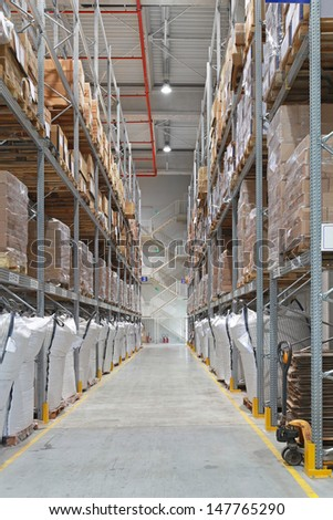 Distribution center warehouse interior with high shelves