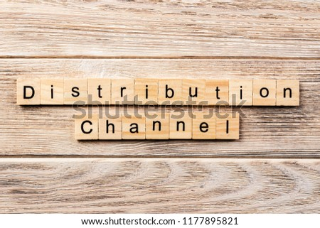 distribution channel word written on wood block. distribution channel text on table, concept. #1177895821