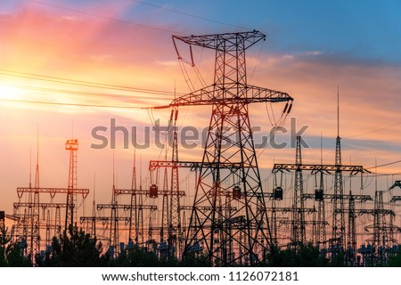 distribution electric substation with power lines and transformers, at sunset #1126072181