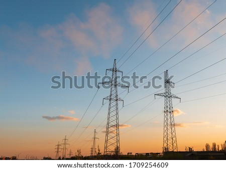 distribution electric substation with power lines and transformers, at sunset Stock photo ©