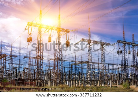 distribution electric substation with power lines and transformers, at sunset #337711232