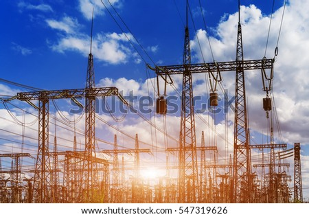 distribution electric substation with power lines and transformers, at sunset #547319626
