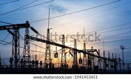 distribution electric substation with power lines and transformers, at sunset. horizontal frame. electrical distribution stations. distribution electric substation with power lines and transformers,