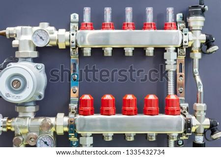 Distribution node, collector water heated floor. Modern heating equipment. #1335432734
