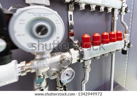 Distribution node, collector water heated floor. Modern heating equipment. #1342949972