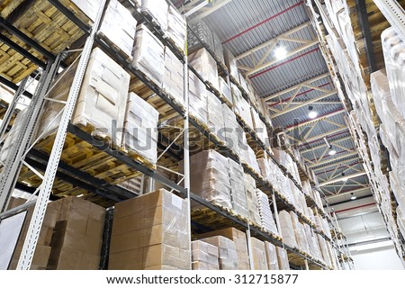 Distribution warehouse with boxes on high shelves