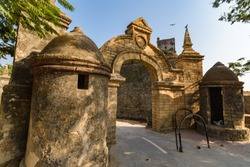 Diu, India - December 2018: A wide angle view of the main entrance gate to the colonial architecture of the ancient Portuguese era fort in Diu Island.