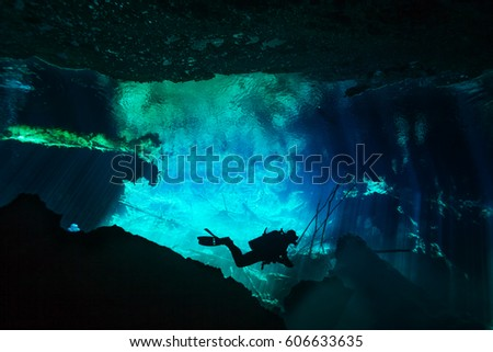 Shutterstock Diver exploring underwater world of Azul cenote