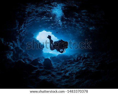diver hovering inside a cave Photo stock ©
