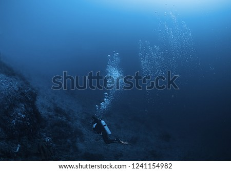 Diver in the ocean, Amed, Bali #1241154982