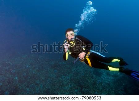 Diver, showing ok sign