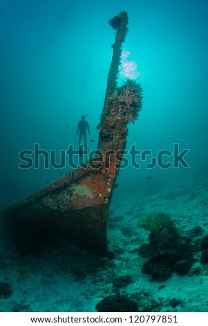 diver silhouette and the sunken ship - stock photo