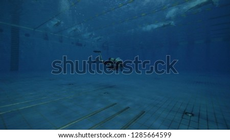 Diver student with scuba tank and scuba mask learning to deep diving in pool #1285664599