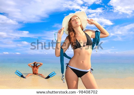 Diver with mask looking at a hot girl on the beach