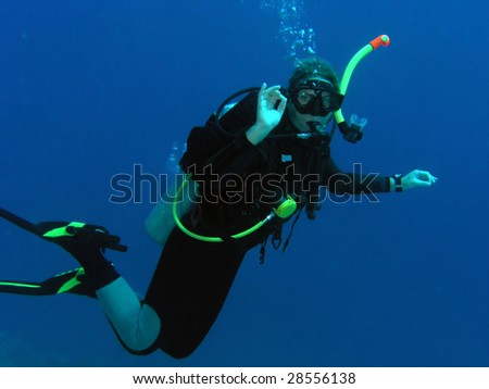 Diver woman underwater - stock photo