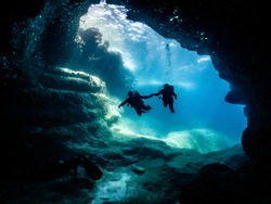 divers entering a cave system