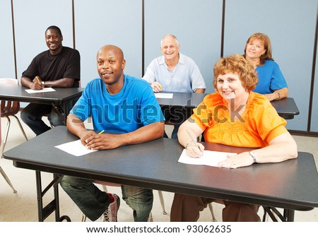 Diverse adult education class, various ages and ethnicities, smiling and happy.
