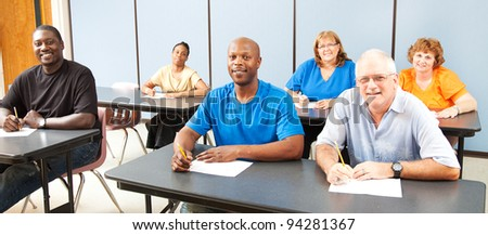 Diverse adult education or college class.  Wide angle banner.
