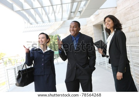 Diverse attractive business man and woman team at office building