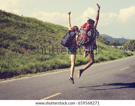 Shutterstock Diverse Backpacker Women Jumping The Street