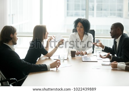 Diverse business partners arguing about bad contract at meeting in lawyers office, disgruntled clients disputing about scam fraud in law firm, cheated investors having claims dissatisfied with loan