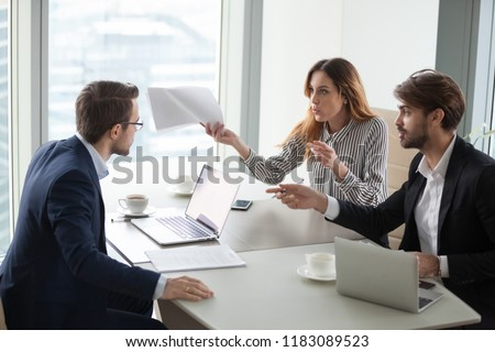 Diverse business partners disagree with company CEO on contract terms, people have dispute or fight at meeting in office, associates or colleagues argue at briefing failing cooperation or partnership #1183089523