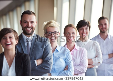 diverse business people group standing together as team  in modern bright office interior #339867062