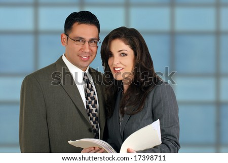 Diverse business team looking over a file