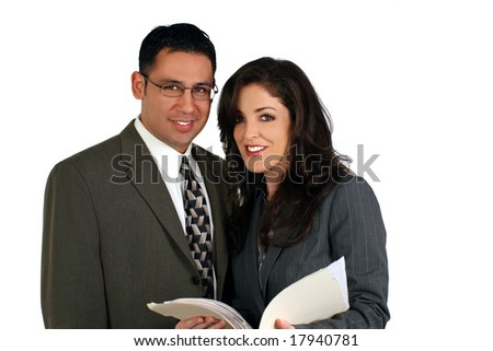 Diverse business team looking over a file - isolated on white