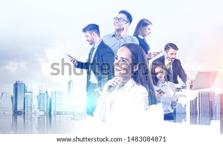 Diverse business team working together with gadgets over cityscape background. Concept of teamwork and communication. Toned image double exposure