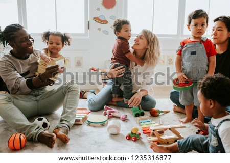 Diverse children enjoying playing with toys #1235316877