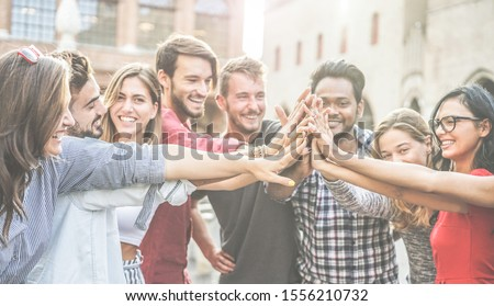 Diverse culture students stacking hands outdoor - Young happy people celebrating together - Youth, lifestyle, university, relationship, human resources, work and friendship concept - Focus on hands Сток-фото ©