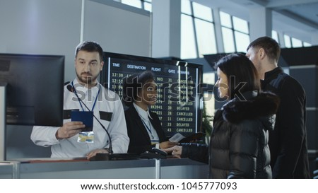 Diverse employees of airport checking passports and biometric data working with passengers.