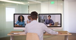 Diverse group of business associates having internet based web conference over video chat