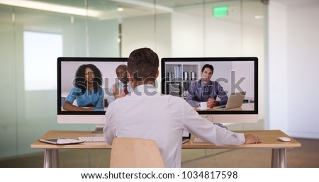 Diverse group of business associates having internet based web conference over video chat #1034817598