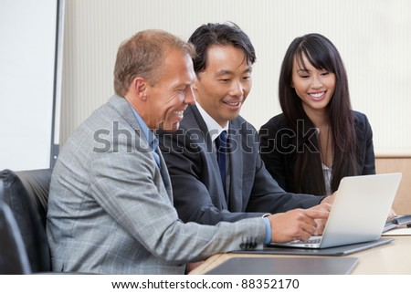 Diverse group of businesspeople working on laptop