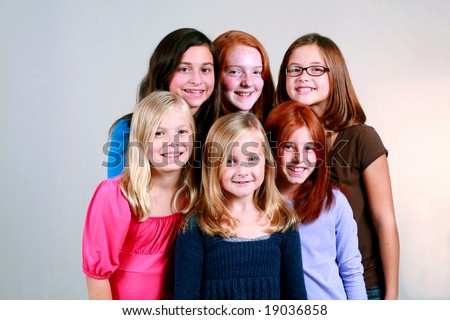 diverse group of cute young girls smiling