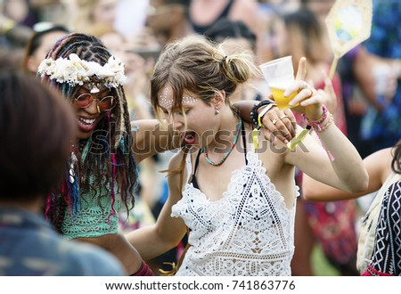 Diverse group of people enjoying a road trip and festival #741863776