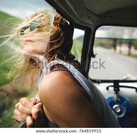 Diverse group of people enjoying a road trip and festival #764819953