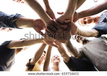 Diverse Group of People Hands Together Partnership Teamwork #619716611