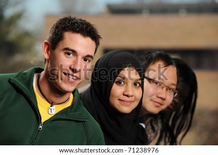 Diverse Group of Students smiling with college campus on the background