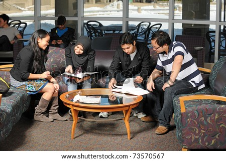 Diverse group of students studying at the College campus - stock photo