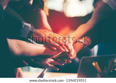 Diverse group of successful business people showing unity with their hands together, Image of businesspeople hands on top of each other as symbol of their partnership. Teamwork agreement concept.  #1396019051