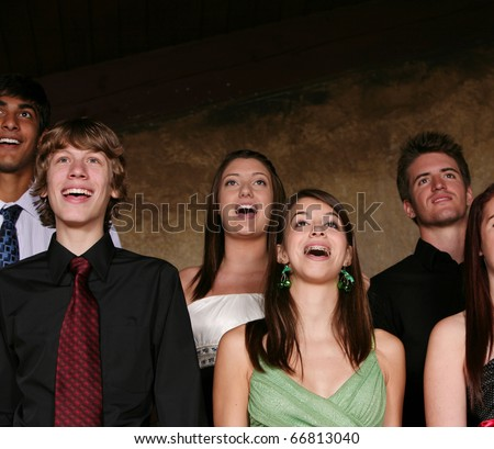 diverse group of teens singing