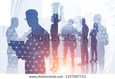 Diverse manager team members silhouettes over modern cityscape background with double exposure of planet hologram. International company concept. Toned image