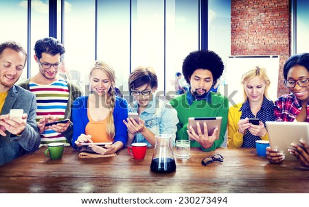 diverse people digital devices...