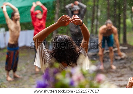 Diverse people enjoy spiritual gathering A multigenerational group of people are seen standing in a circle in a forest clearing, worshipping native cultures during a mindful congregation in nature.